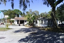Canal front house & business bldgs in Port Orange, FL